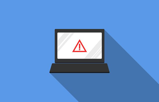 Grafik eines Laptops mit Ausrufezeichenschild
